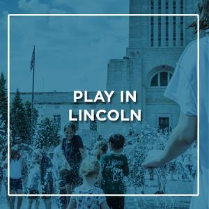 Blue Background and Play in Lincoln text